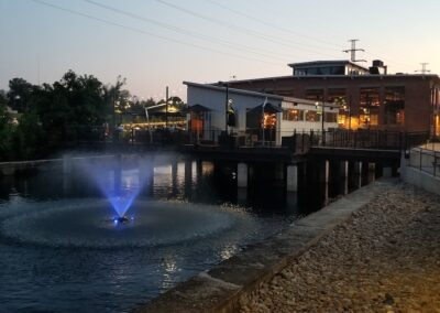 Revolution Mill at dusk with Fountains